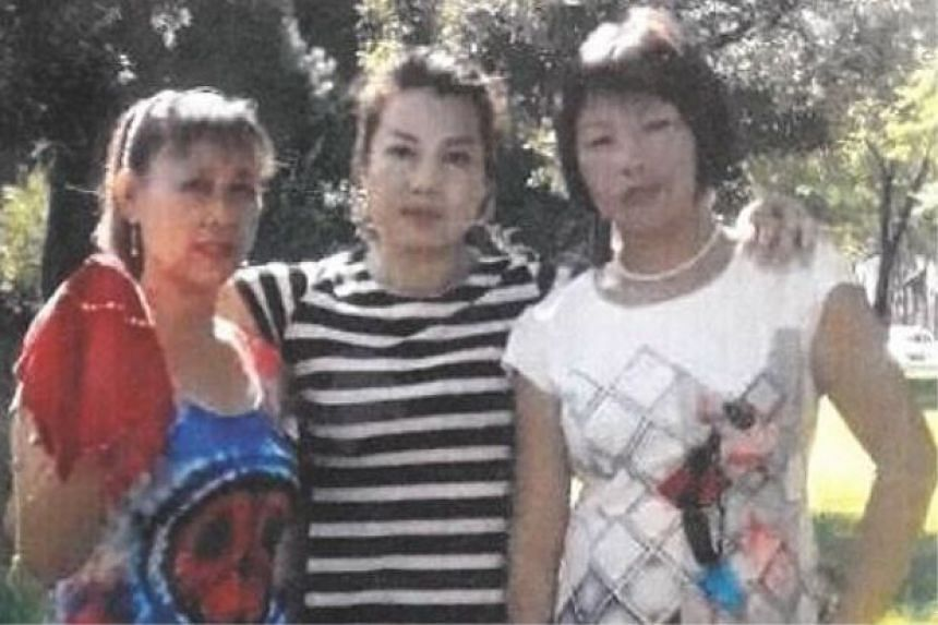 The three suspects, believed to be China nationals, in an image provided by the police.