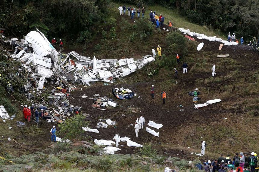 Rescue crew work at the wreckage of a plane that crashed into the Colombian jungle with Brazilian soccer team Chapecoense onboard near Medellin on Nov 29, 2016.