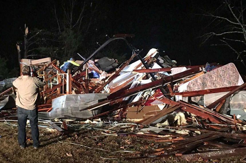 A handout photo shows tornado damage to a home near Tuscumbia, Alabama, Nov 29, 2016.