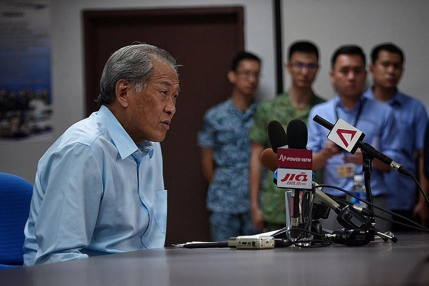 Dr Ng speaking to reporters during his visit to Choa Chu Kang military camp yesterday. Addressing the issue of the detention of SAF armoured vehicles in Hong Kong, he said the vehicles did not contain any controlled military items that would require