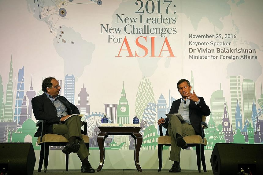 Dr Balakrishnan (at right) at a panel discussion during The Straits Times Global Outlook Forum yesterday. With him is ST associate editor (global affairs) Ravi Velloor, who was the moderator. The foreign minister noted that within Singapore, the Gove