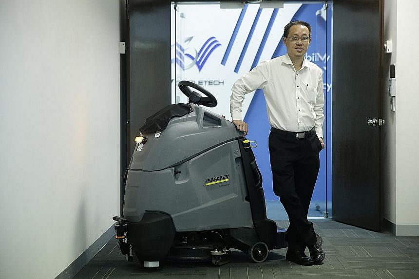 Mr Long with an autonomous maintenance machine. He says the key component of the V3Transformer technology is the intelligent robotic brain, which his company can retrofit onto any existing mechanical sweeper or scrubber in the cleaning industry.