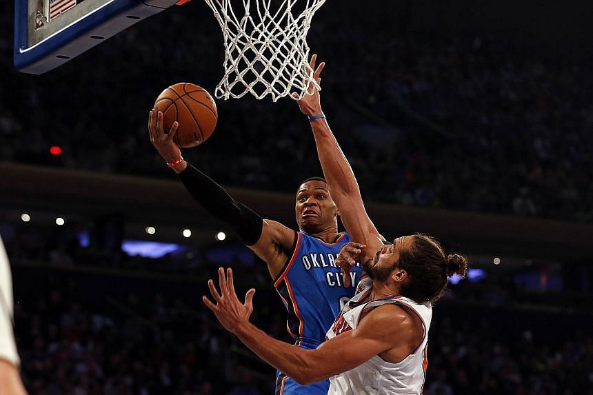 Thunder guard Russell Westbrook drives to the basket past Knicks centre Joakim Noah at Madison Square Garden. Westbrook finished with 27 points, 18 rebounds and 14 assists.