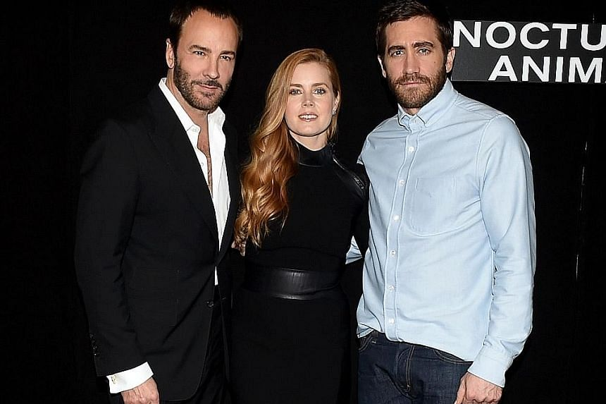 From left: Tom Ford, Amy Adams and Jake Gyllenhaal at the photo call for Nocturnal Animals in Los Angeles last month.