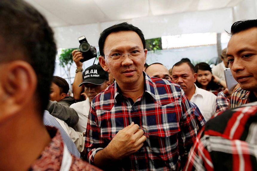 Jakarta Governor Basuki Tjahaja Purnama leaves the stage after meeting with supporters while campaigning for the upcoming election for governor in Jakarta, Indonesia on Nov 16, 2016.