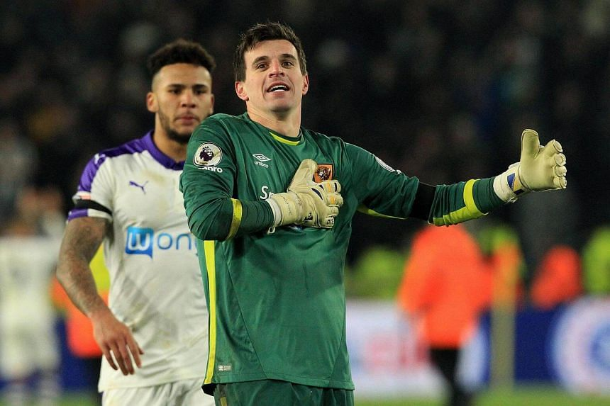 Hull City's Swiss goalkeeper Eldin Jakupovic celebrates after he saved a shot during a penalty shoot-out following extra time in the English League Cup quarter-final football match at the KCOM Stadium in Kingston upon Hull on Nov 29, 2016.