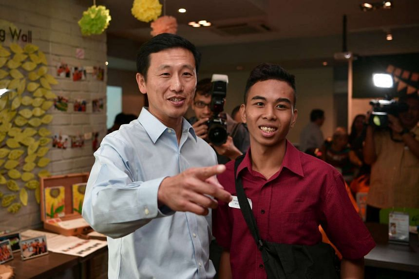 Minister for Education (Higher Education and Skills) Ong Ye Kung poses with Muhammad Rizuwan Bin Abdullah, a participant in the first year of the pilot S2W transition programme at the Enabling Village on Nov 30, 2016.
