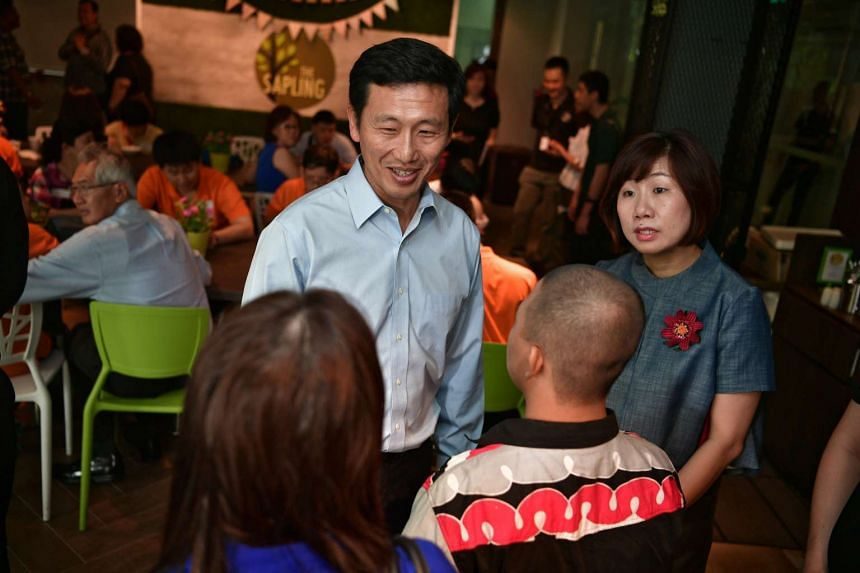 Minister for Education (Higher Education and Skills) Ong Ye Kung and SG Enable CEO Ku Geok Boon speak with participants of the S2W transition programme at the Enabling Village on Nov 30, 2016.