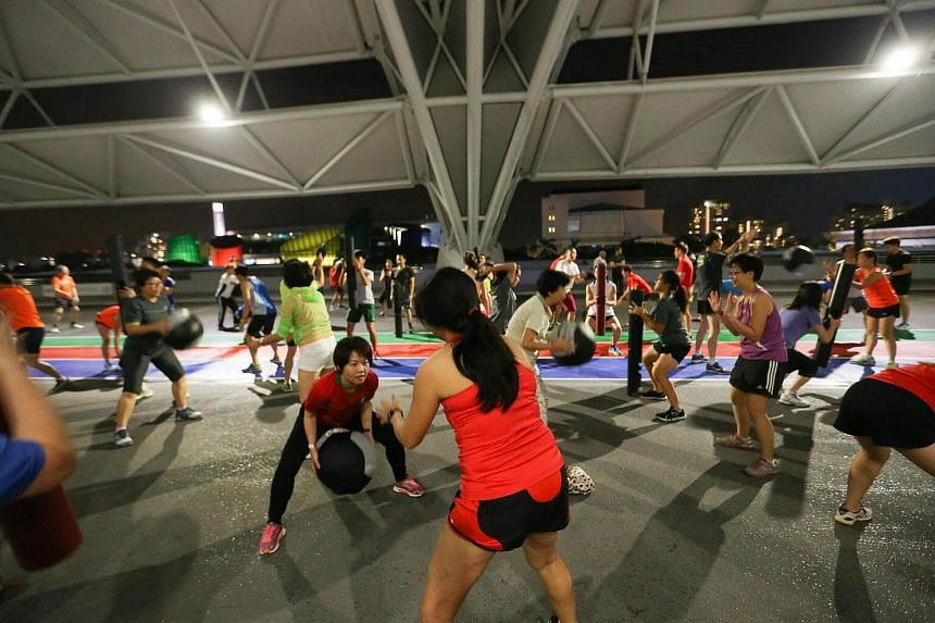 Participants undergoing a loaded movement training during the launch of the ActiveSG Running Clinic held at the Sports Hub on Jan 15, 2016.
