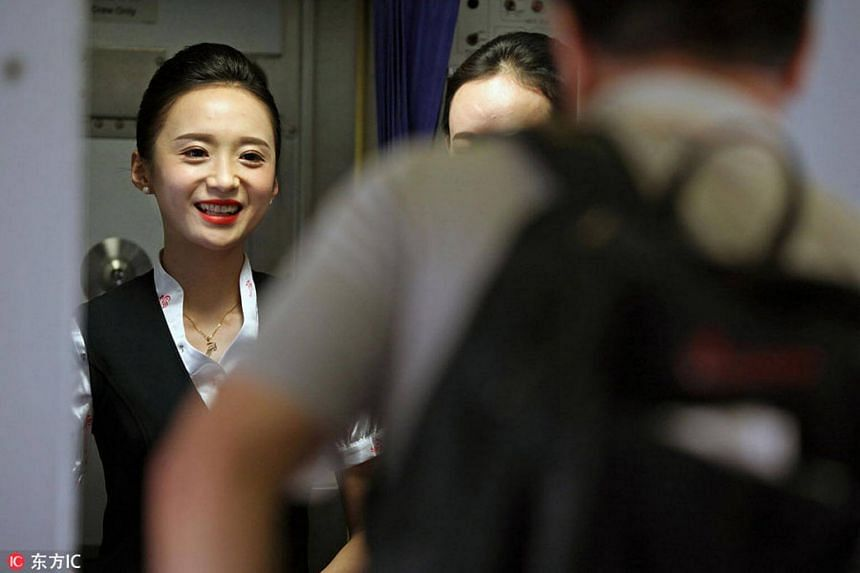 Liu Miaomiao says goodbye to passengers when the plane arrives at Beijing International Airport, on Nov 28, 2016.