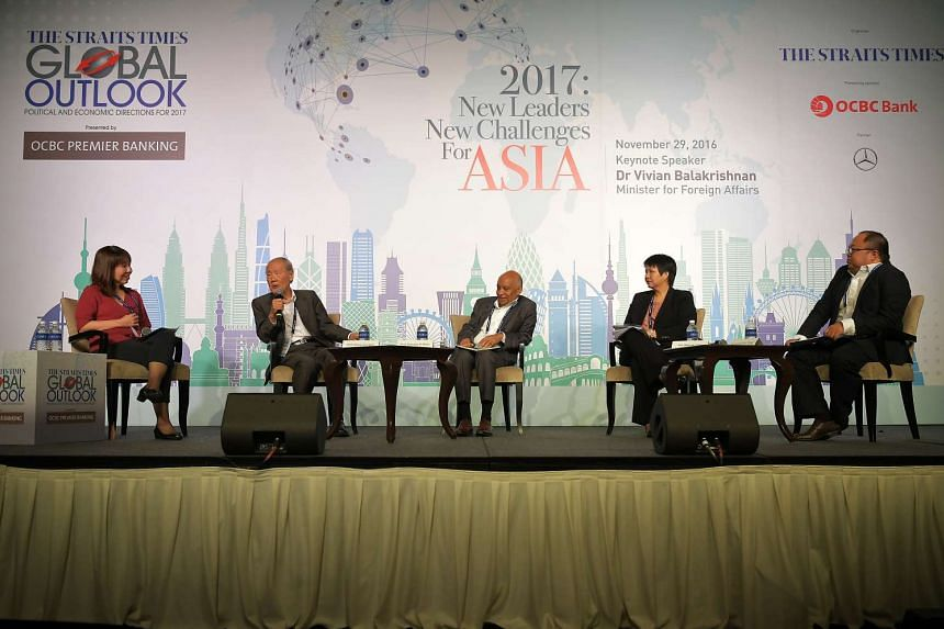 At the panel discussion of the ST Global Outlook Forum yesterday were (from left) ST foreign editor Audrey Quek, who served as moderator; Prof Wang; Professor Subrata K. Mitra, director of the Institute of South Asian Studies; Ms Selena Ling, OCBC Ba