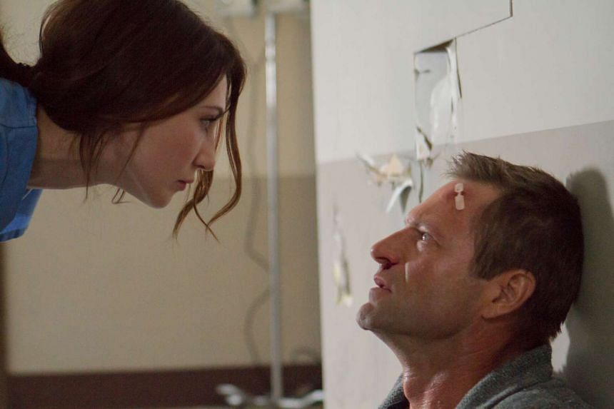 Carice van Houten plays the mother of the boy Aaron Eckhart (both above) is trying to exorcise in the horror movie Incarnate.