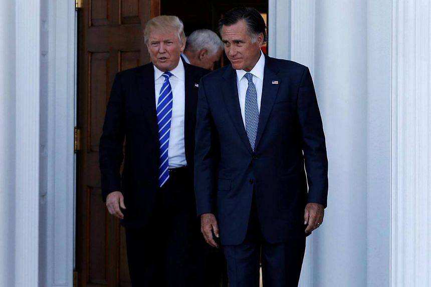 US President-elect Donald Trump and former Massachusetts Governor Mitt Romney emerge after their meeting at the main clubhouse at Trump National Golf Club in Bedminster, New Jersey on Nov 19, 2016.