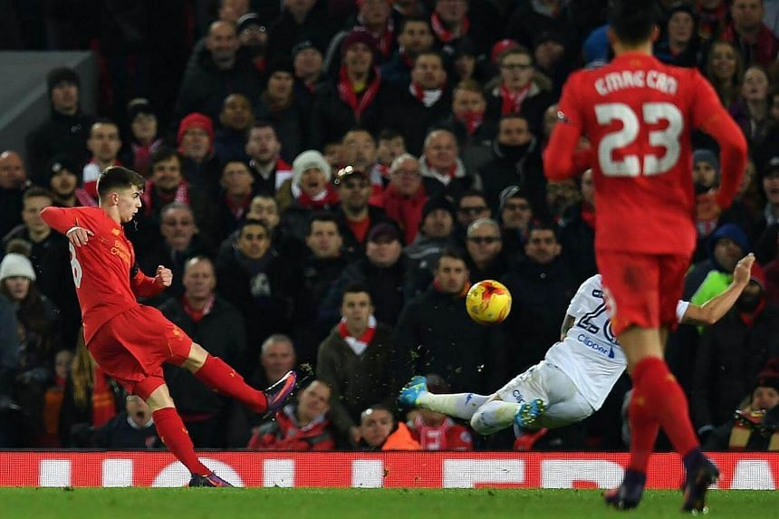 Liverpool's Welsh striker Ben Woodburn scoring his team's second goal during the English League Cup quarter-final football match between Liverpool and Leeds United, on Nov 29, 2016.