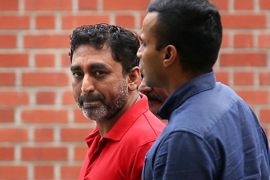 Zackeer Abbass Khan (in red), who allegedly hired a secret society headman to slash a rival's face, is taken to a coffee shop at Serangoon Avenue 2, where the attack was believed to have been planned.