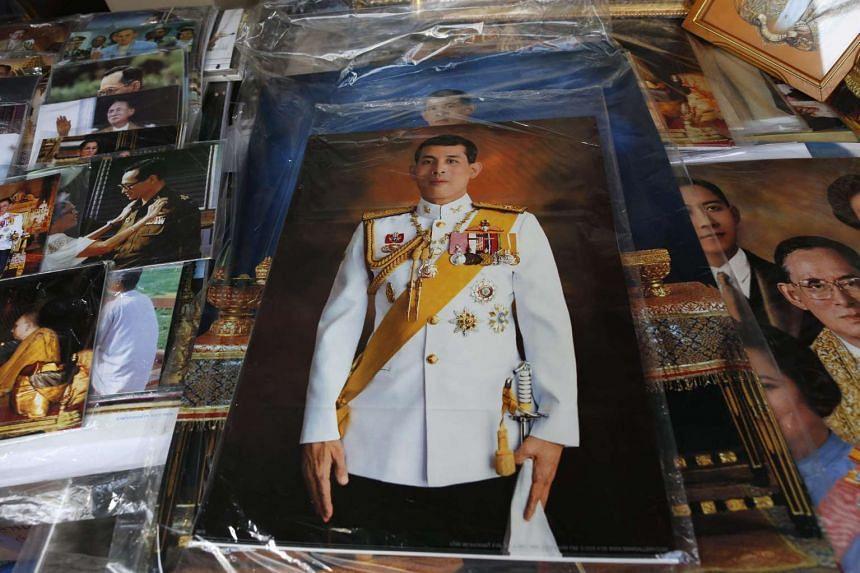 Photographs of Thai Crown Prince Maha Vajiralongkorn are displayed at a shop in Bangkok on Nov 29, 2016.