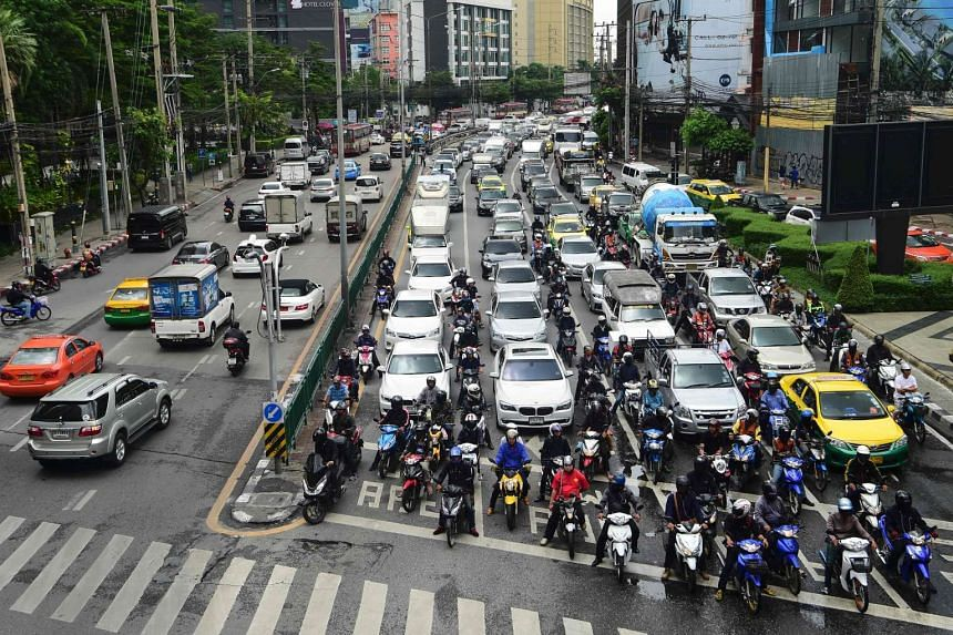 Vehicles wait at a traffic intersection on a main road in Bangkok on Sept 13, 2016.