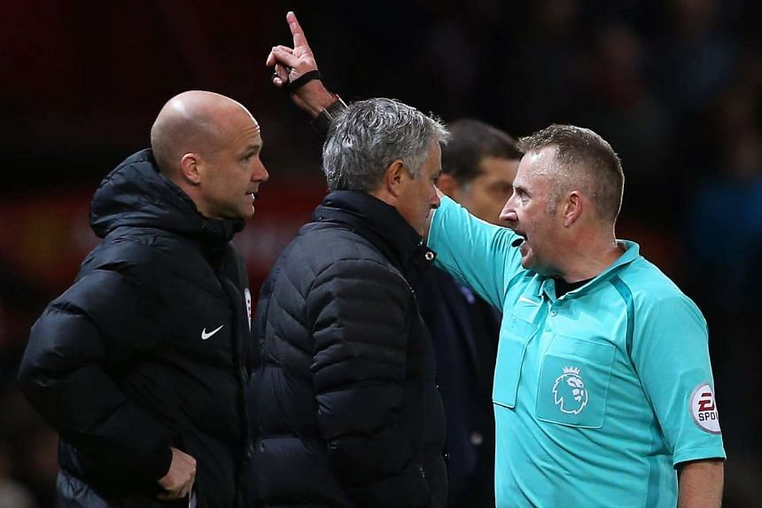 Mourinho (centre) is sent off by referee Jonathan Moss (right) during the match against West Ham on Nov 27, 2016.