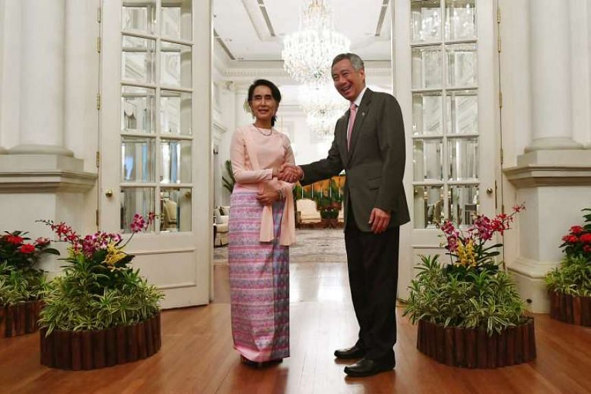 Her Excellency Daw Aung San Suu Kyi pays a courtesy call on Prime Minister Lee Hsien Loong at the Istana on Nov 30, 2016, during her official visit to Singapore.