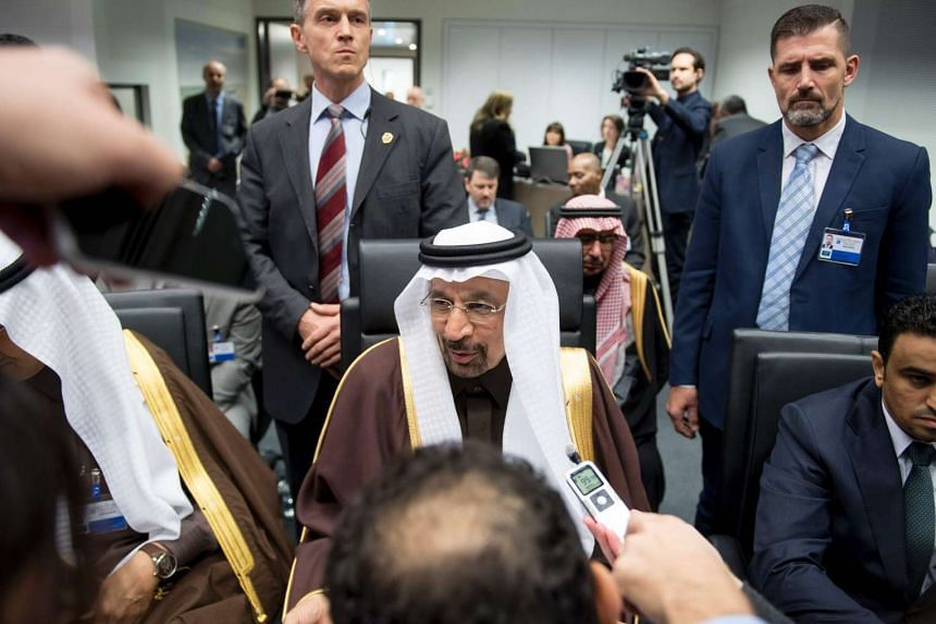 Saudi Arabia's energy minister Khalid al-Falih (centre) speaks with journalists at the Opec meeting.