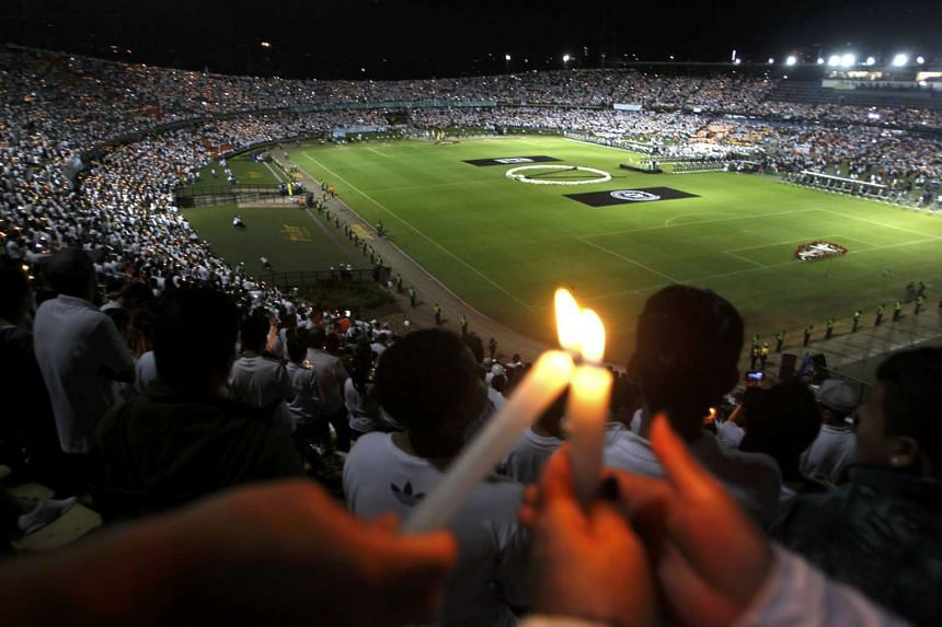 Fans of Atletico Nacional soccer club light candles as they pay tribute to the players of Brazilian club Chapecoense killed in the recent airplane crash, in Medellin, Colombia, on Nov 30, 2016.