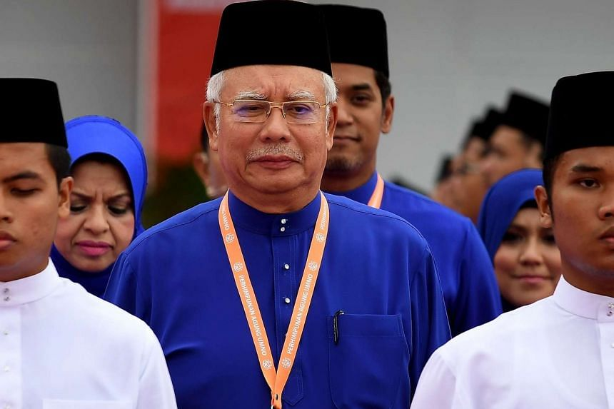 Malaysian Prime Minister Najib Razak arrives to address the annual congress of his ruling party, the United Malays National Organisation (UMNO) in Kuala Lumpur on Dec 1, 2016.