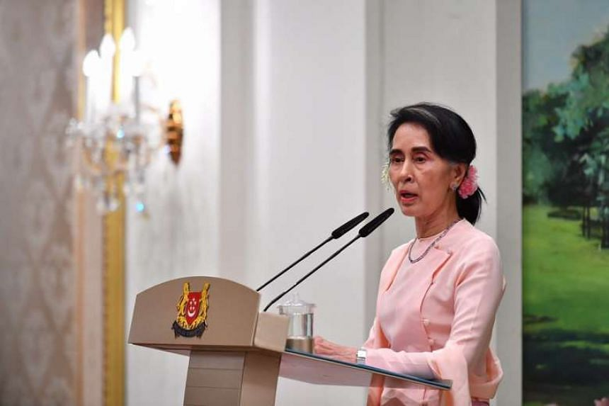 Myanmar state counsellor Aung San Suu Kyi speaks during a dinner hosted by Prime Minister Lee Hsien Loong on Wednesday (Nov 30).