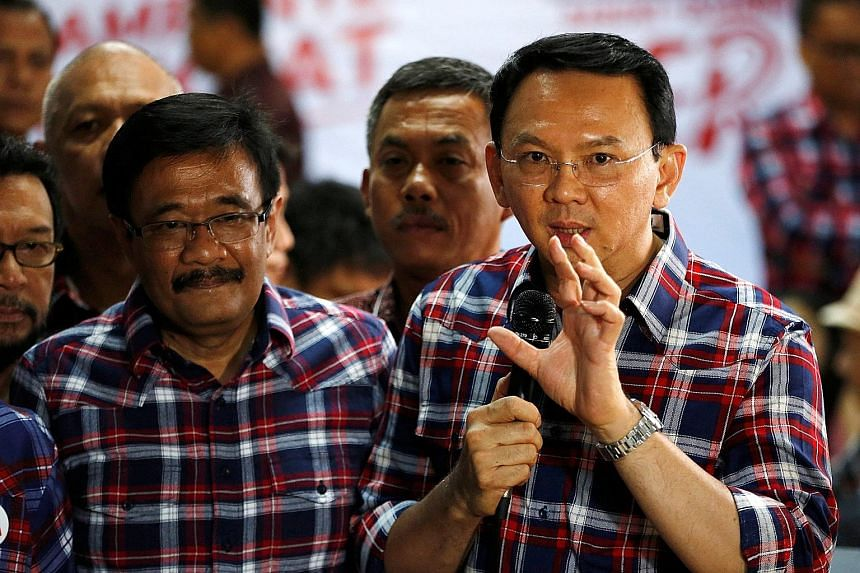 Mr Basuki (at right), with his deputy, Mr Djarot Saiful Hidayat, speaking last month to reporters about the blasphemy complaint against him. The two incumbents are defending their posts in Jakarta's gubernatorial election taking place in February.