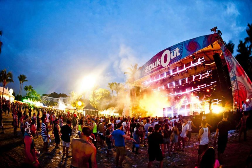 Revellers at the annual beach festival ZoukOut. At least 23 police reports have been made by victims who were tricked into paying for ZoukOut tickets online.