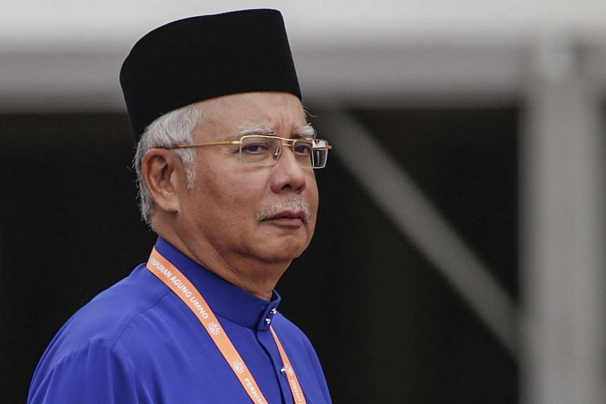 Umno party president and Malaysian Prime Minister Najib Razak looks on during the opening ceremony of the party's 70th General Assembly in Kuala Lumpur on Dec 1, 2016.