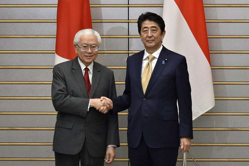 Singapore President Tony Tan Keng Yam (left) shakes hands with Japan's Prime Minister Shinzo Abe at the start of their meeting at Mr Abe's official residence in Tokyo on Dec 1, 2016.