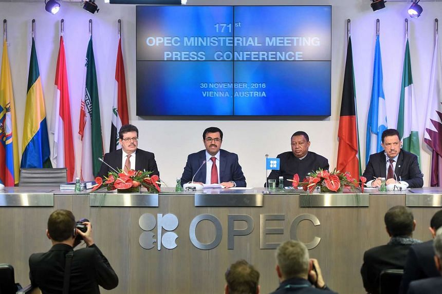 (From left to right) Mohamed Hamel, chairman of OPEC, Mohammed Al-Sada, Qatar's minister of energy and industry and president of OPEC, Mohammed Barkindo, secretary general of OPEC, and Hasan Hafidh, head of public relations of OPEC, attend a news con
