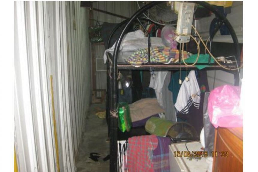 Cramped sleeping quarters in containers and make-shift zinc huts.