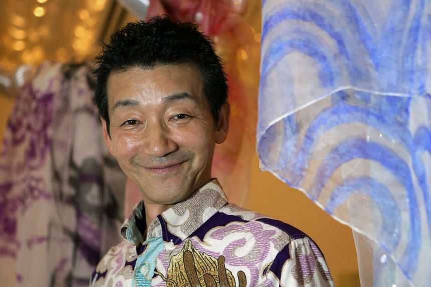 Kazuaki Kameda wearing a Pagong shirt. Next to him is one of his silk-screen scarves.