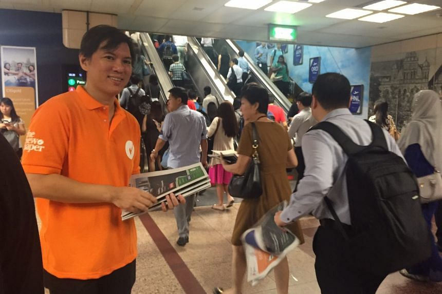 TNP editor Eugene Wee distributing copies of the freesheet at Raffles Place on Thursday (Dec 1).