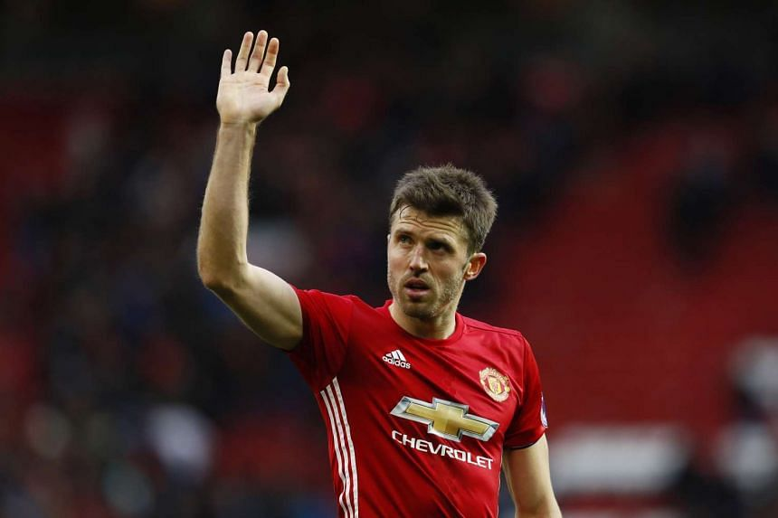Manchester United midfielder Michael Carrick waves to the crowd during their match against Arsenal on Nov 19, 2016.