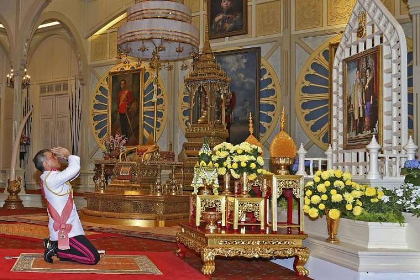 The newly crowned king of Thailand, Maha Vajiralongkorn Bodindradebayavarangkun, 64, pays his respects before a portrait of his parents at the Dusit Palace in Bangkok on Dec 1, 2016.