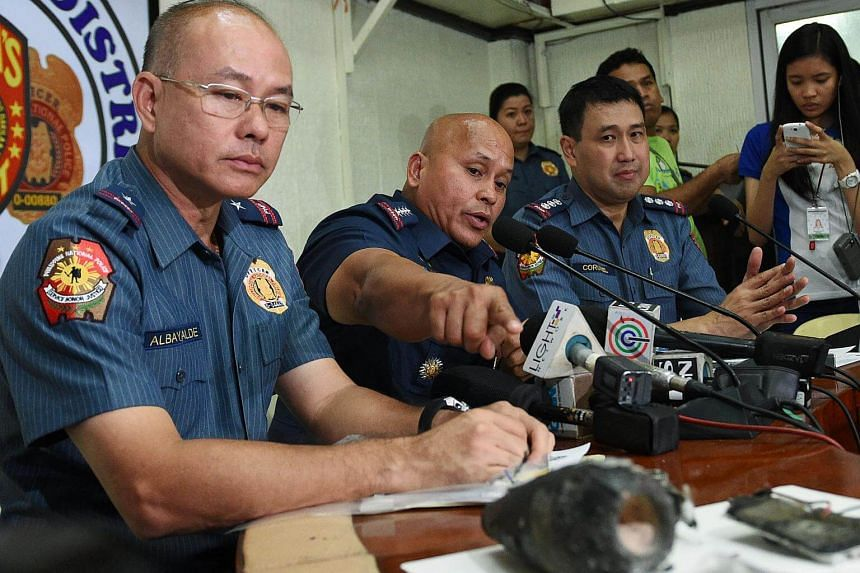 Philippine police chief Director-General Ronald Dela Rosa talks about the improvised explosive device found by a street sweeper near the US embassy during a press conference at the police headquarters in Manila on Nov 28, 2016.
