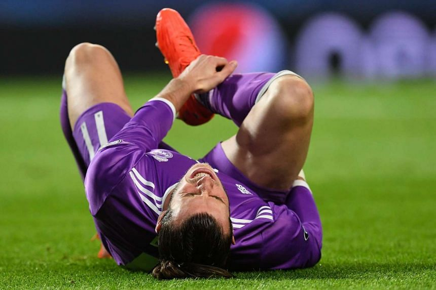 Real Madrid's Welsh forward Gareth Bale grimaces as he lies on the pitch during the Uefa Champions League match on Nov 22, 2016.