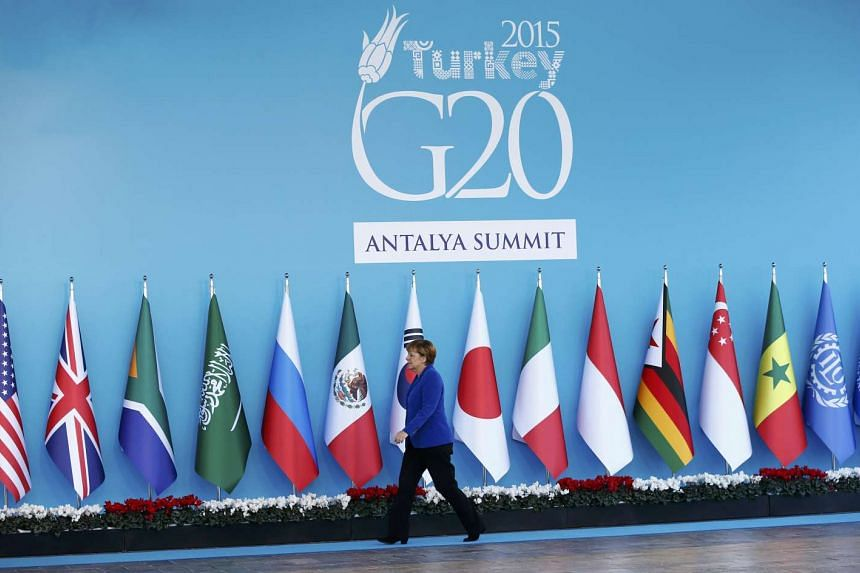 German Chancellor Angela Merkel arrives for a welcoming ceremony during the Group of 20 (G20) leaders summit in the Mediterranean resort city of Antalya, Turkey on Nov 15, 2015.
