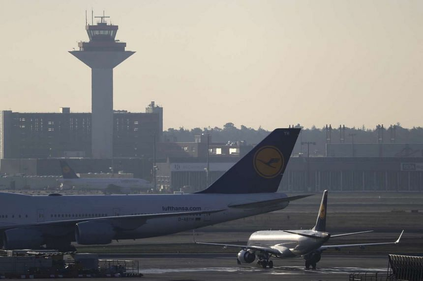 Planes stand on the tarmac during a pilots' strike of German airline Lufthansa at Frankfurt airport, Germany on Nov 30, 2016.