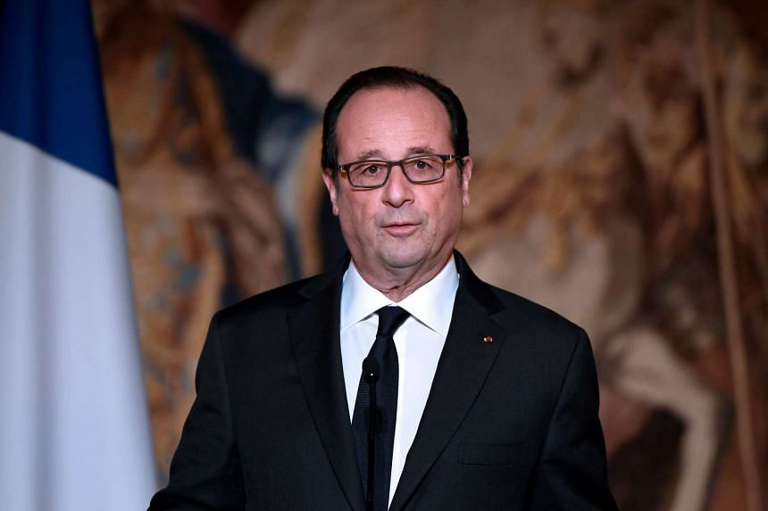 French President Francois Hollande delivers a speech after awarding the Legion of Honour to Olympic and Paralympic athletes in Paris on Dec 1, 2016.