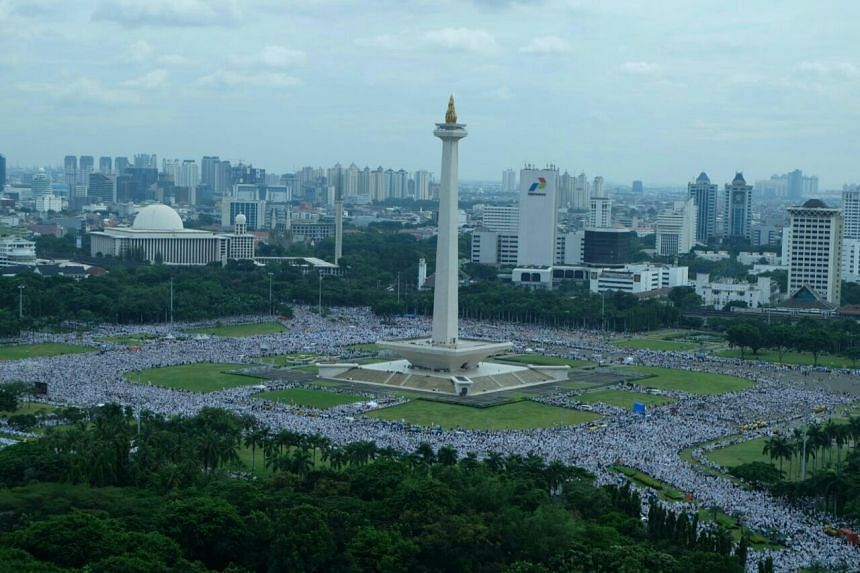 Protestors marching towards the National Monument (Monas) in Central Jakarta on Friday morning (Dec 2).