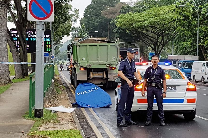 Police were alerted to the accident in Woodlands Centre Road yesterday at 5.58am. The motorcyclist was pronounced dead at the scene and the tipper truck driver was arrested for causing death by a negligent act.