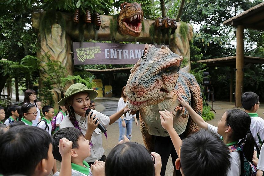 In A Very Electric Christmas, actors wearing glow-in-the-dark wires on their clothes act out a play about a bird which has lost its way. Dinosaurs come back to life at the Singapore Zoo (see D4 for story).