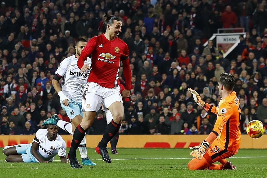Manchester United's Zlatan Ibrahimovic scoring the opener in the League Cup quarter-final against West Ham. He had a brace, while team-mate Anthony Martial also netted twice.