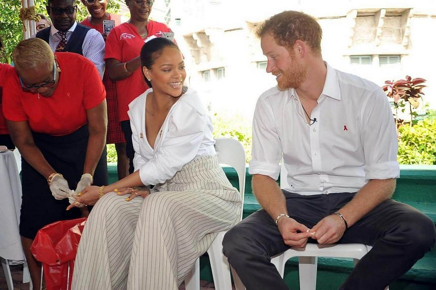 Britain's Prince Harry takes an HIV test alongside singer Rihanna to highlight World AIDS Day in Bridgetown, Barbados on Dec 1, 2016.