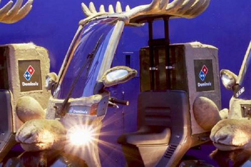 Reindeer-ornamented bikes, which Domino's Japan will now be using.