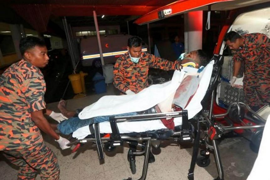 RTM cameraman Muhamad Amirul Amin Amir being rushed to the hospital.