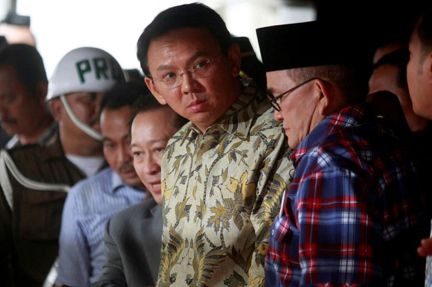 In Indonesia's ideological war, Jakarta Governor Basuki, seen here leaving the A-G's office in Jakarta yesterday, represents the reformists together with President Joko. They are pitted against entrenched interests in the form of former president Yudhoyon